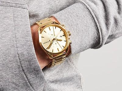 ساعت مچی بند فلزی طلایی